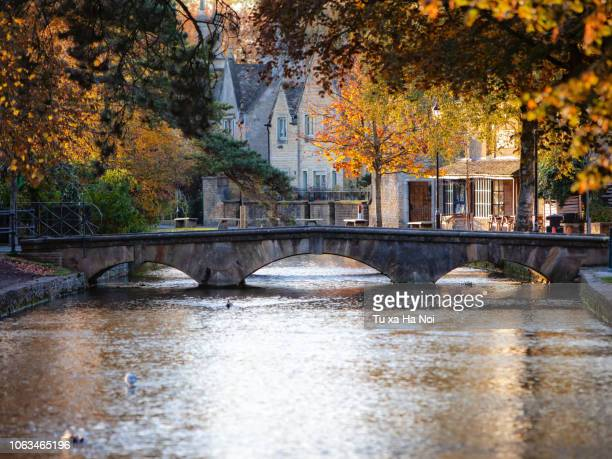 bourton-on-the-water in an early autumn morning - stow on the wold stock pictures, royalty-free photos & images