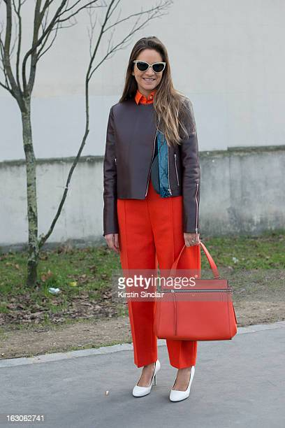Boutique owner Laure Heriard du Breuil wears Prism sunglasses Celine bag trousers jacket shirt and shoes on day 4 of Paris Womens Fashion Week...