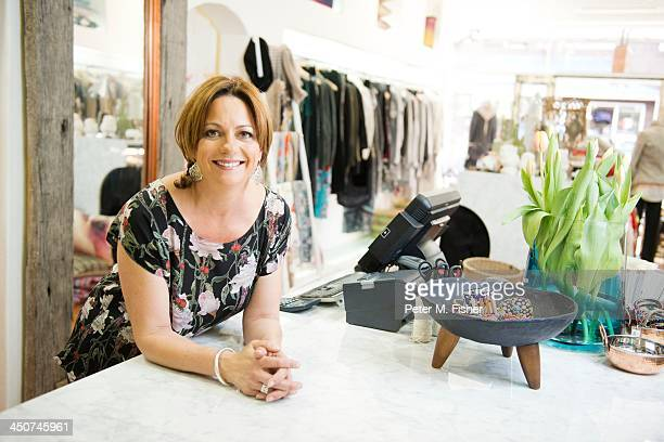 Boutique owner smiling and looking at camera