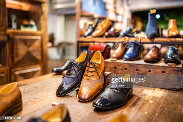 boutique shoes in a store - calzature di pelle foto e immagini stock