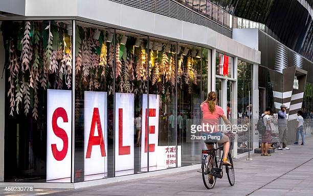 A boutique shop is doing promotion for sale Chinas retail sales grew 12% in the first 10 months of the year down from 13% for the same period last...