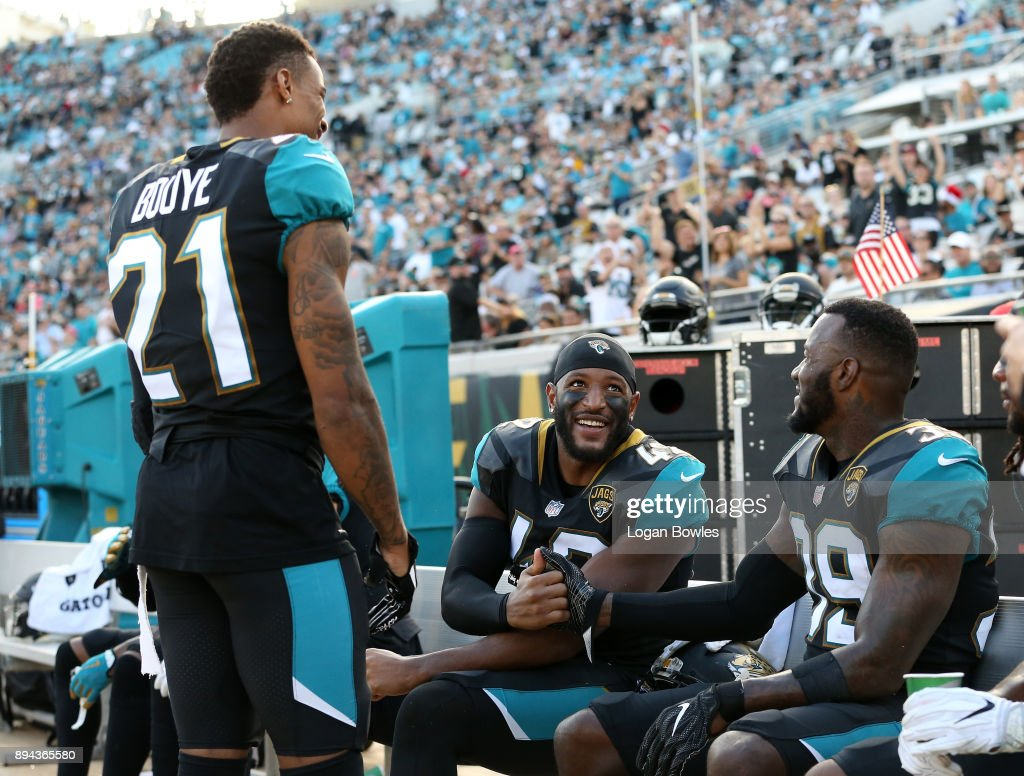 A.J. Bouye #21, Barry Church #42 and Tashaun Gipson #39 of the Jacksonville Jaguars celebrate on the bench late in the second half of their game against the Houston Texans at EverBank Field on December 17, 2017 in Jacksonville, Florida.