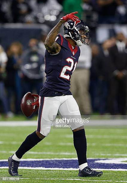 J Bouye of the Houston Texans celebrates after intercepting a pass from Connor Cook of the Oakland Raiders in their AFC Wild Card game at NRG Stadium...