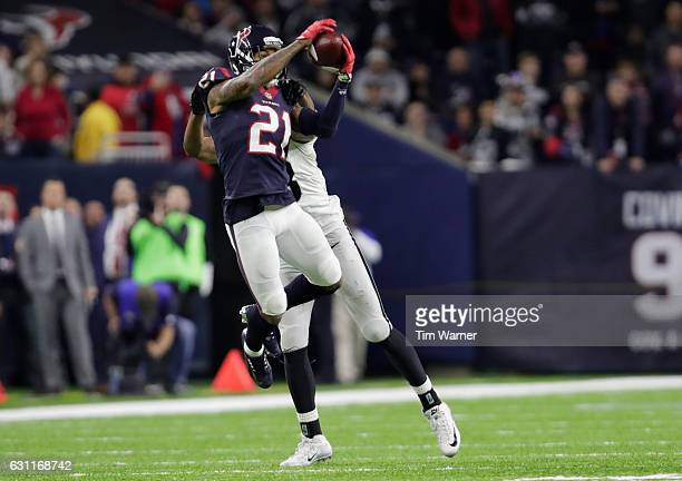 J Bouye of the Houston Texans intercepts a pass from Connor Cook of the Oakland Raiders during the second half of their AFC Wild Card game at NRG...