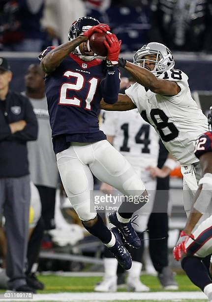 J Bouye of the Houston Texans intercepts a pass from Connor Cook of the Oakland Raiders in their AFC Wild Card game at NRG Stadium on January 7 2017...