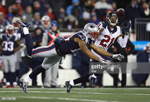 J Bouye of the Houston Texans intercepts a pass in the second quarter against the New England Patriots during the AFC Divisional Playoff Game at...