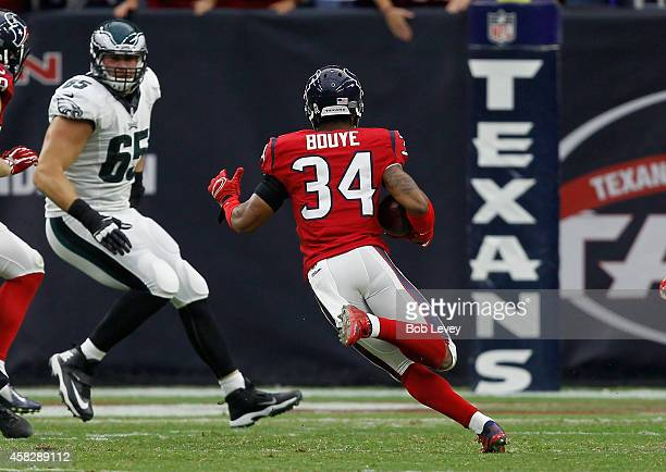 J Bouye of the Houston Texans returns an interception for a touchdown against the Philadelphia Eagles at Reliant Stadium on November 2 2014 in...