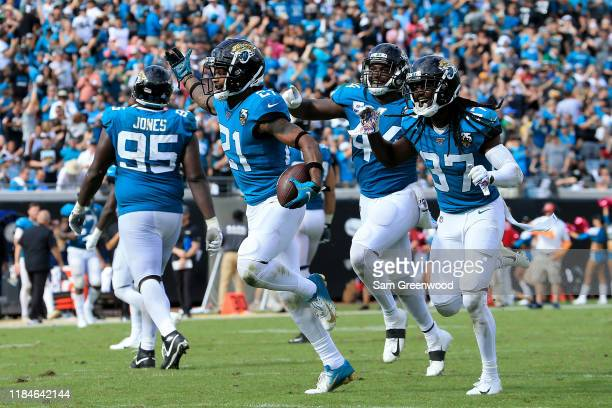 J Bouye of the Jacksonville Jaguars celebrates an interception during the game against the New York Jets at TIAA Bank Field on October 27 2019 in...
