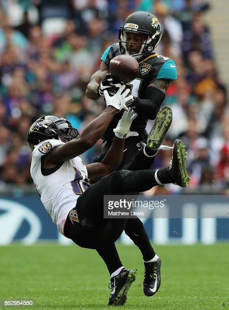 J Bouye of the Jacksonville Jaguars intersects the ball from Jeremy Maclin of the Baltimore Ravens during the NFL International Series match between...