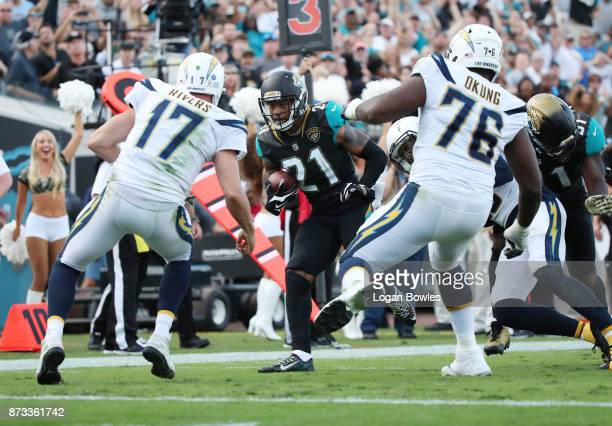 J Bouye of the Jacksonville Jaguars runs with the football after an interception in overtime of their game against the Los Angeles Chargers at...