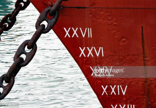 bow, anchor chains and depth markers on an old sailing ship - military ship stock pictures, royalty-free photos & images