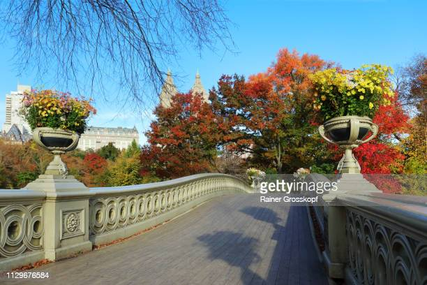 Bow Bridge decorated with flower pots in Autumn