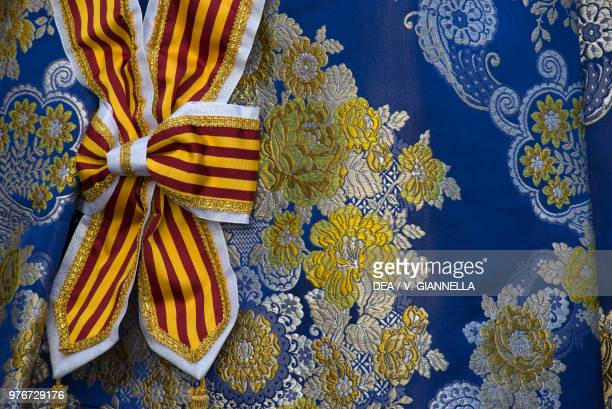 Bow detail from a dress worn by one of the Falleras festival queens detail Fallas festival Valencia Spain
