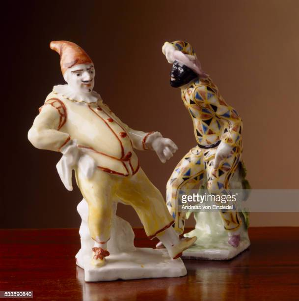 Bow (c1750-1755) figurines of a harlequin and a palcinella from Wallington, Northumberland