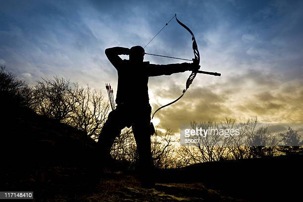 bow hunter silhouette in nature