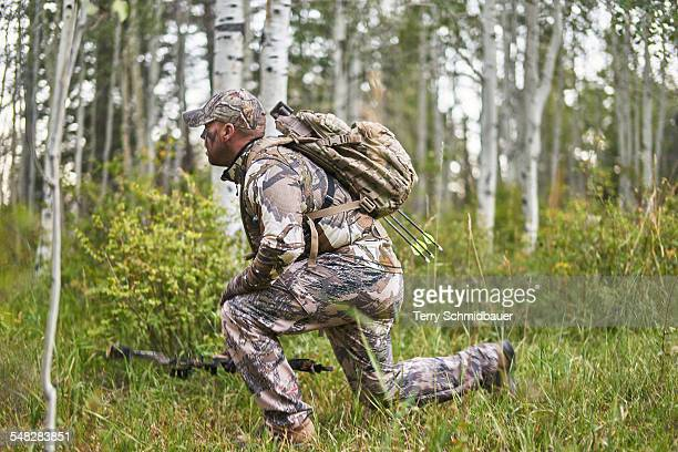 bow hunting for deer in pagosa springs colorado. - camouflage clothing stock pictures, royalty-free photos & images