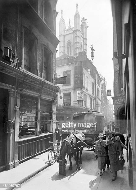 Bow Lane looking south City of London c1930 A horse is eating from its nosebag in the narrow lane The 'Olde Watling' tavern visible on the corner of...