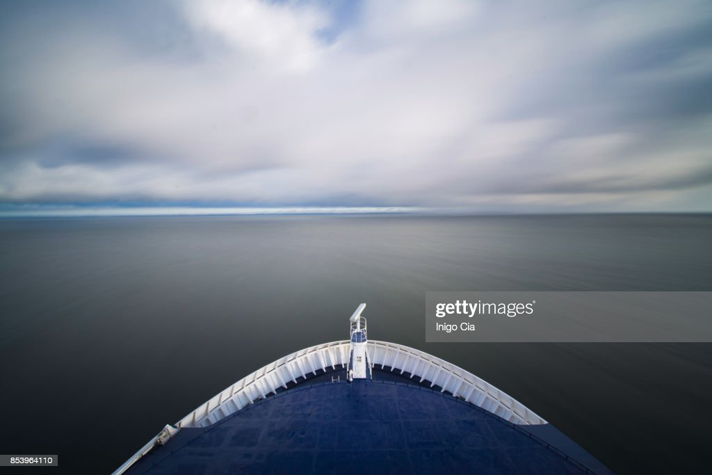 Bow of a big boat sailing the ocean : Stock Photo