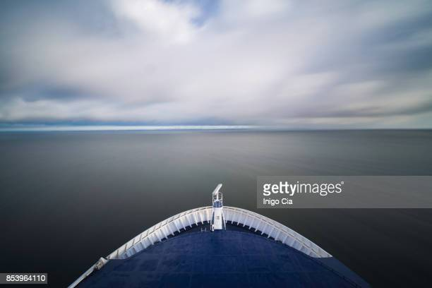 bow of a big boat sailing the ocean - ship front view stock-fotos und bilder