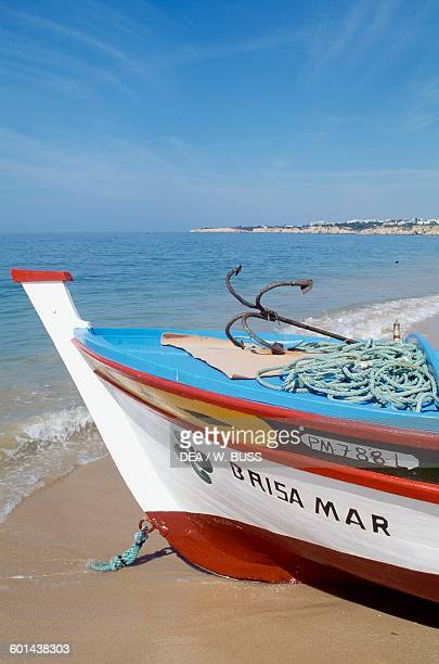 Bow of a fishing boat on the beach Armacao De Pera Algarve Portugal