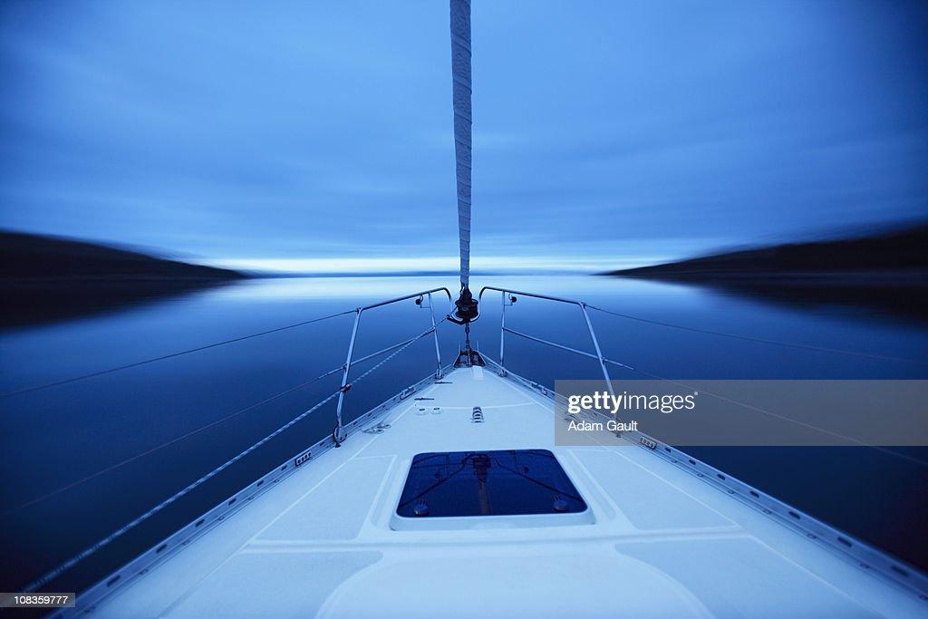 Bow of boat sailing on lake : Stock Photo