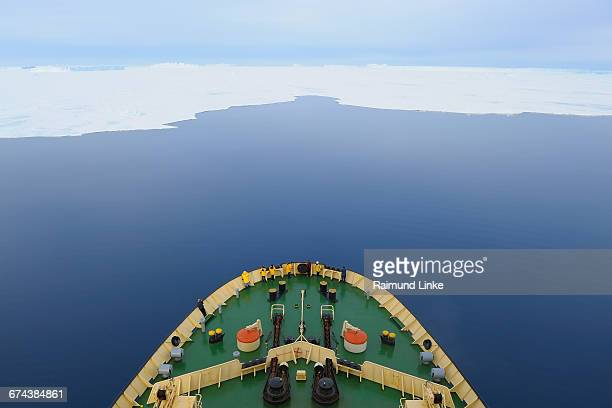 bow of icebreaker  in calm sea - weddell sea stock photos and pictures