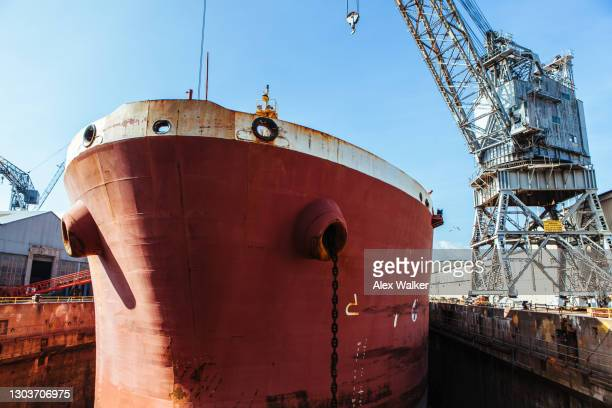 bow of large ship in dry dock - passenger craft stock pictures, royalty-free photos & images