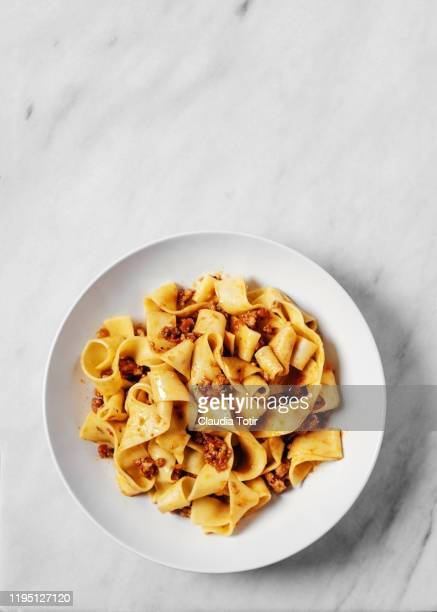 bow of pappardelle on white background - pasta stock pictures, royalty-free photos & images