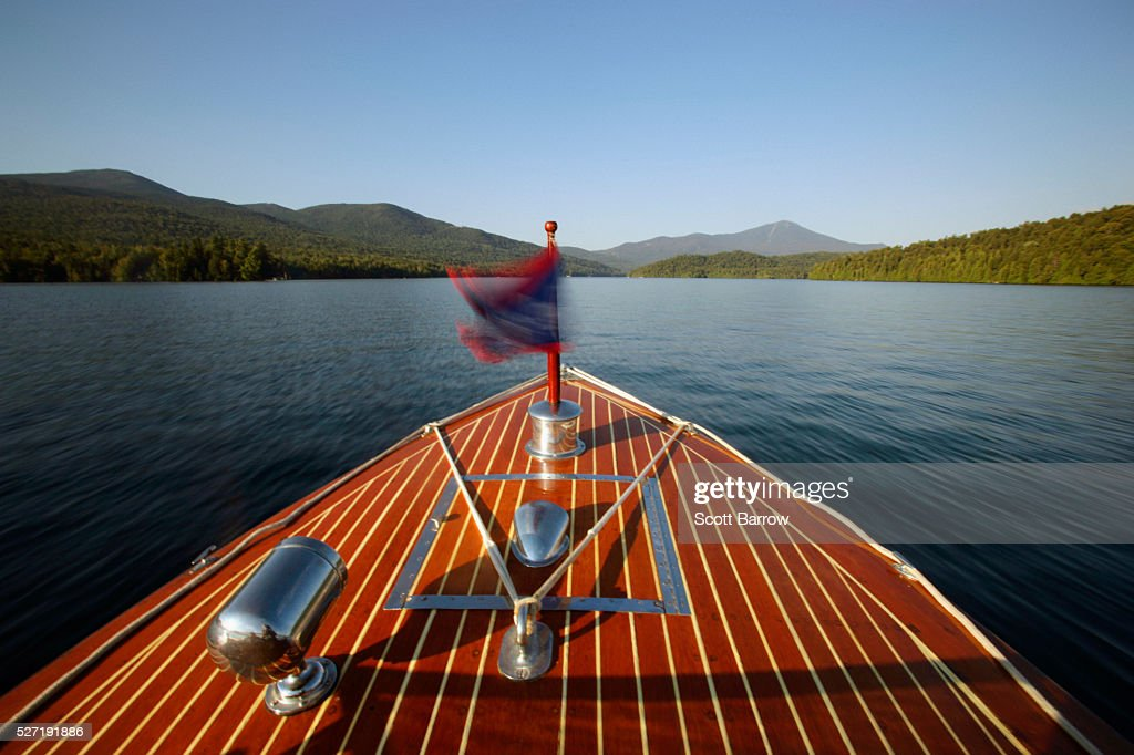Bow of wooden inboard motorboat on a lake : Stock Photo