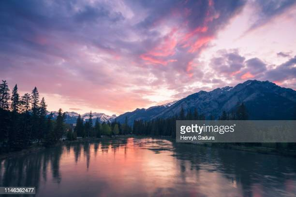 bow river at sunset in banff national park, alberta, canada - sulphur mountain stock pictures, royalty-free photos & images