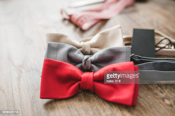 bow ties on table in tailor shop - bow tie stock pictures, royalty-free photos & images