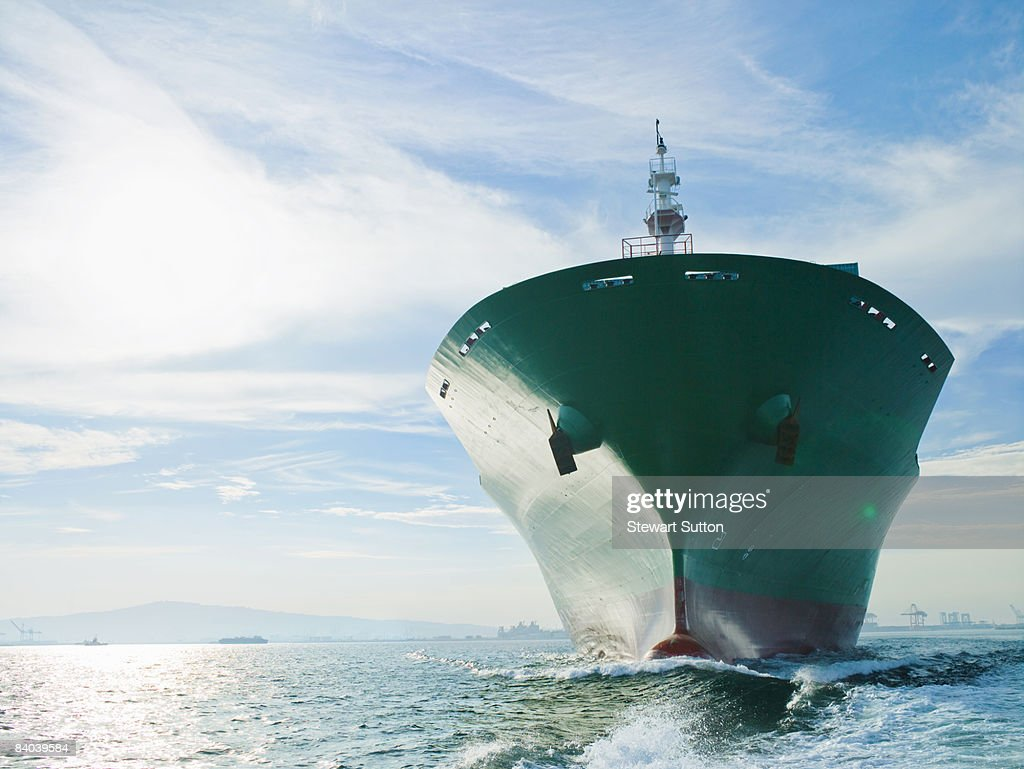 Bow view of cargo ship sailing on ocean : Stock Photo