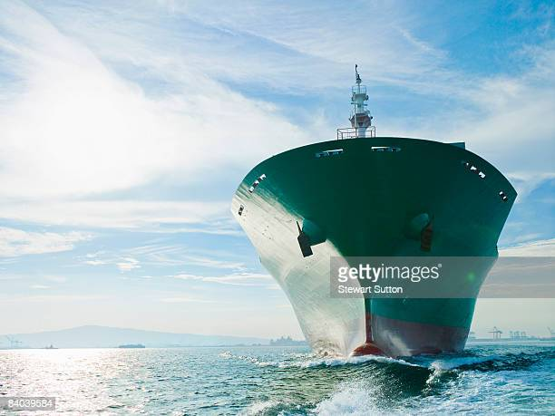 bow view of cargo ship sailing on ocean - slave ship stock photos and pictures