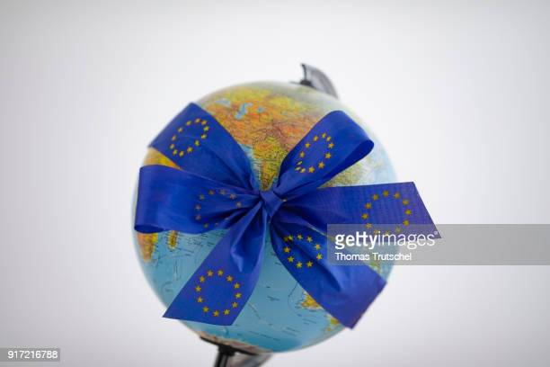 A bow with the logo of the European Union is bound around a globe on February 08 2018 in Berlin Germany