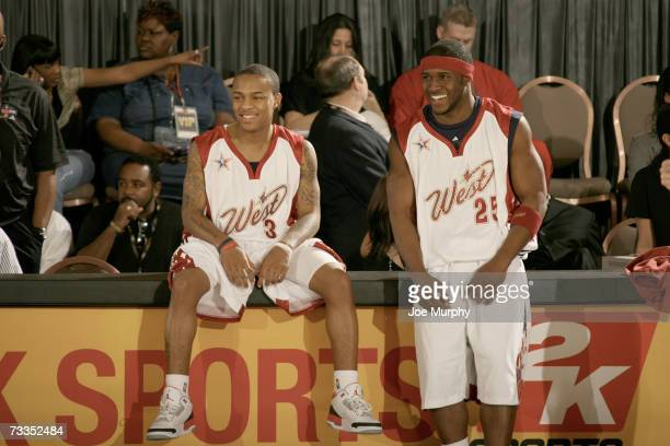 Bow Wow actor and singer and Reggie Bush NFL player for the New Orleans Saints chat before the McDonald's NBA AllStar Celebrity Game Presented by 2K...