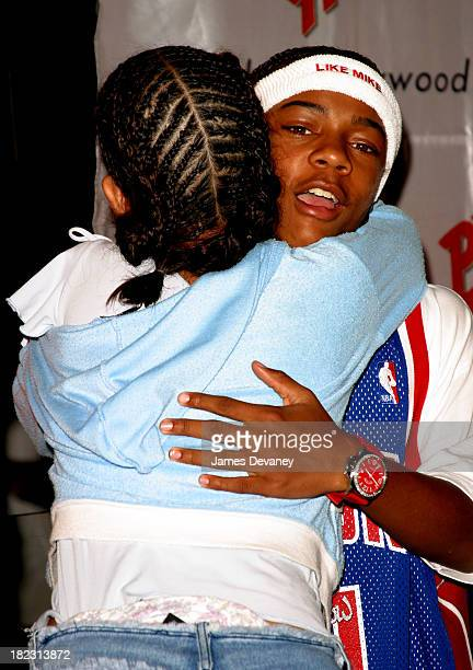 Bow Wow hugs fan during Bow Wow promotes Like Mike at Planet Hollywood Times Square in New York City New York United States