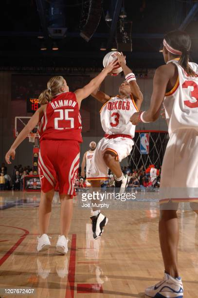 Bow Wow of the Clutch City shoots the ball against Becky Hammon of the HTown during the McDonald's NBA AllStar Celebrity Game at NBA Jam Session...
