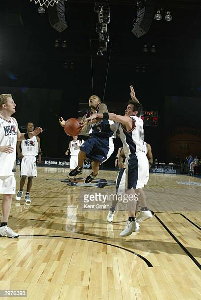 Bow Wow of the East Team gets fouled as he attempts a shot by Dean Cain of the West Team during the NBA Entertainment League Game part of 2004 NBA...
