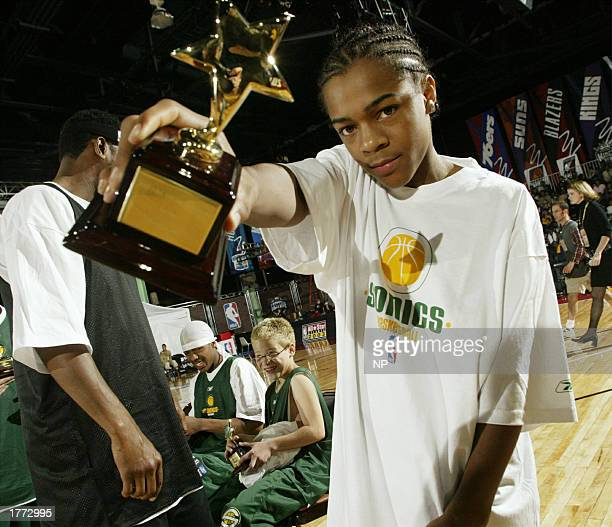 Bow Wow shows off his first place trophy from the Celebrity Shooting Stars competition on February 9 2003 at the NBA All Star 2003 Jam Session in...