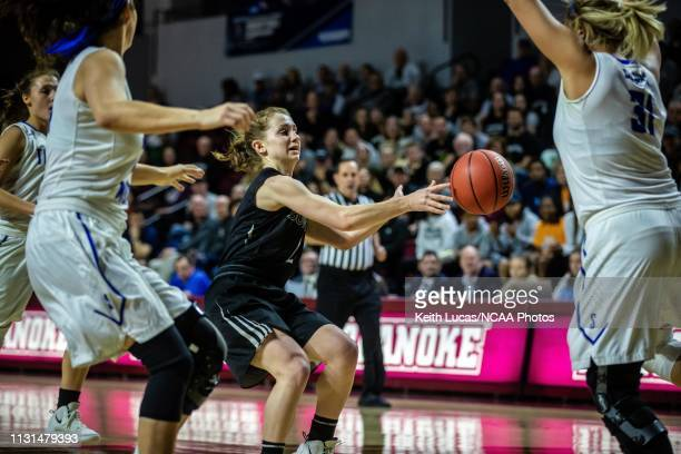 Bowdoin Bears guard Samantha Roy dishes the pass around the defense of Thomas More Saints forward Emily Schultz during the Division III Women's...