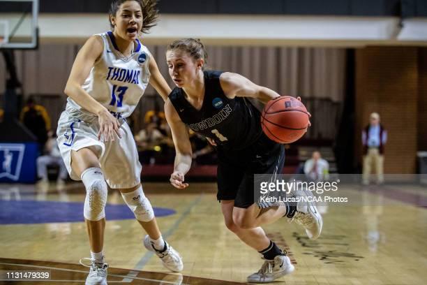 Bowdoin Bears guard Samantha Roy drives past Thomas More Saints guard Asyah Mitchell during the Division III Women's Basketball Championship held at...