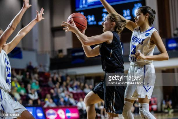 Bowdoin Bears guard Samantha Roy shoots despite the close out of Thomas More Saints forward Shelby Rupp and the defense of Asyah Mitchell during the...