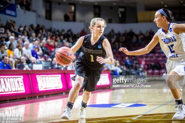 Bowdoin Bears guard Samantha Roy tries to turn the corner as Thomas More Saints guard Kelly Clapper races to cut her off during the Division III...