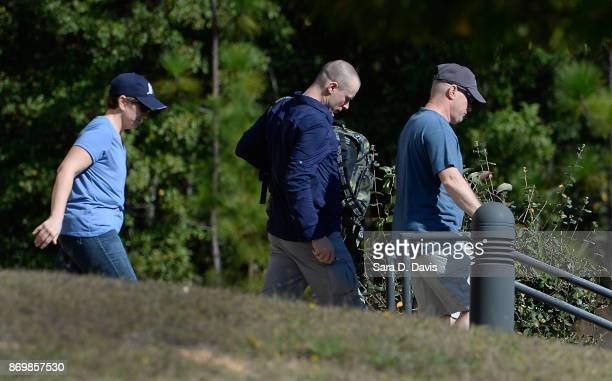 Bowe Bergdah demoted to Private from Sergeant is escorted from the Ft Bragg military courthouse on November 3 2017 in Ft Bragg North Carolina...