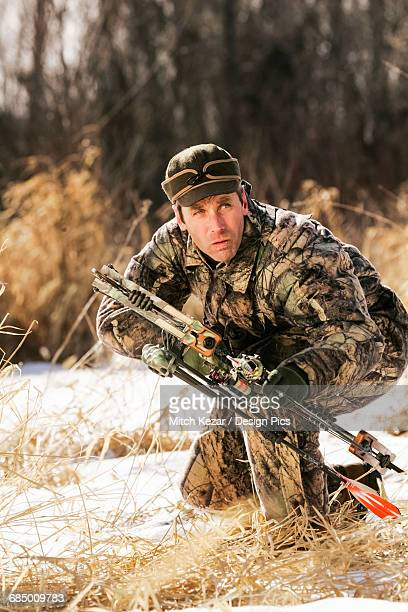 Bowhunter hunting Whitetail Deer Hunt in Winter