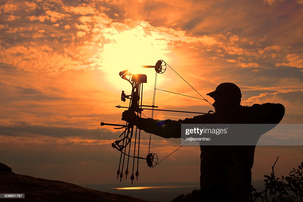 Bowhunter in Sunrise : Stock Photo