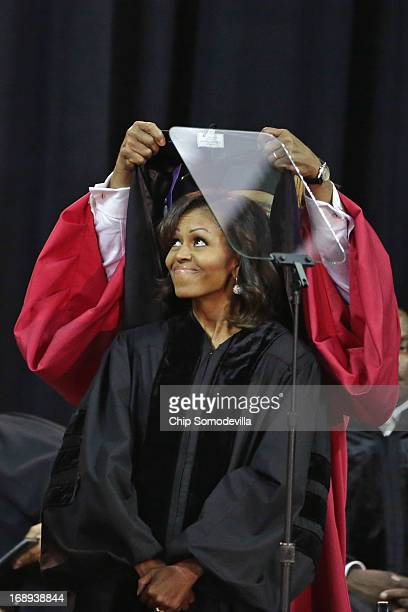 Bowie State University Provost Weldon Jackson places a doctoral hood on US first lady Michelle Obama after she received an Honorary Doctor of Laws...