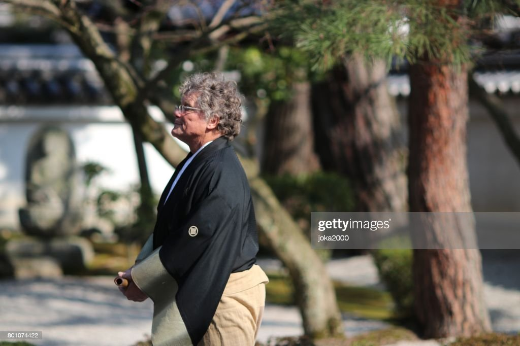 Bowing after Playing Shakuhachi : Stock Photo