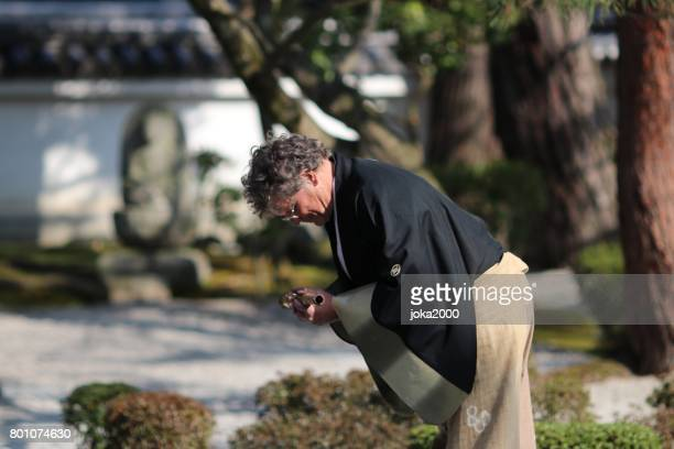 bowing after playing shakuhachi - bamboo flute stock photos and pictures