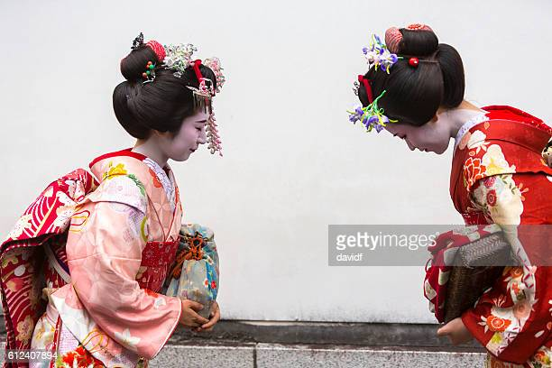 Bowing Maiko Apprentice Geisha Japanese Women Meeting In Traditional Kimonos